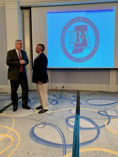 Governor Holcomb conversing with IBA President Brett Harter